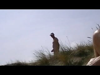 Beach yoyeur in the dunes
