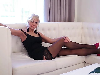 Latvian Hot blonde mature lady Sylvie playing with herself