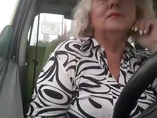 Naughty granny with big natural boobs masturbates in the car