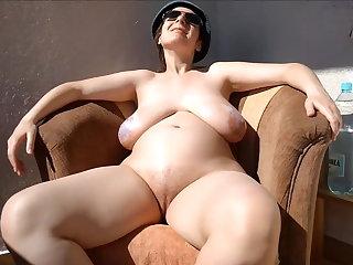 Polish Pregnant woman sunbathing on balcony